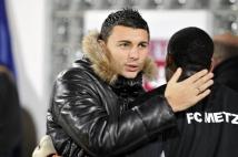 Metz - Le Havre, 11e journée de Ligue 2  : Mathieu Duhamel livre une accolade à son coéquipier, le jeune gardien Anthony MFa.